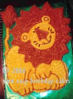 the lion on the cake top cut away the cake from the lion shape