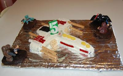 Star Wars X-Wing Fighter Cake with Light Saber Dueling characters